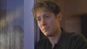 A pensive, 90's haired Spader.